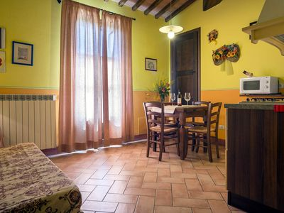 Photo for Il GIRASOLE is a nice apartment with a panoramic balcony over San Gimignano