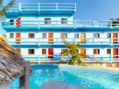 Photo for Enjoy this island paradise with shared pool located right on the bike path