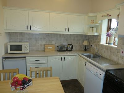 Fully equipped kitchen with cooker, fridge, microwave, kettle and toaster