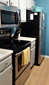 Brand new SS appliances and wood laminate flooring.