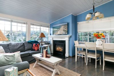 Living Room - Blue walls recall the ocean, skylights let the California sun in, and a jute area rug adds to the beachy feel.