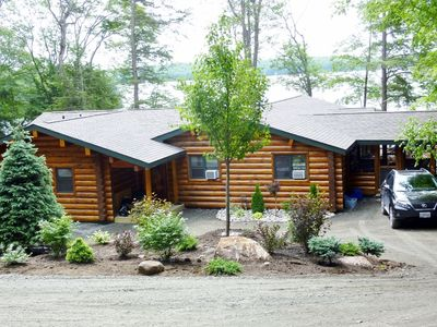 Photo for Luxury log retreat on 5 acres of forest and 300 feet of secluded shoreline