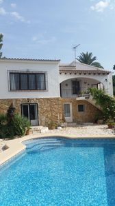 Photo for 10 minute walk to town, 15 to the beach. Detatched villa plenty of sun or shade.