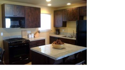 Newly remodeled kitchen with Alder wood cabinets and granite counter tops.