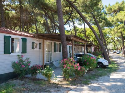 Photo for Mobile home, surrounded by pine trees just a few 100m. from the beach.