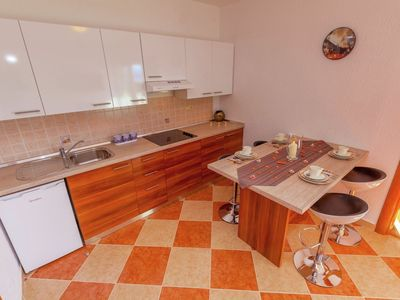 Photo for Tranquil Apartment in Dramalj with Jacuzzi