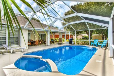 Screen enclosed heated pool with plenty of seats & chaise lounges for all.