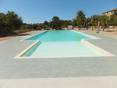 """Photo for New modern house with the use of the pool near the beach and sea of """"Foxi is Sali"""""""