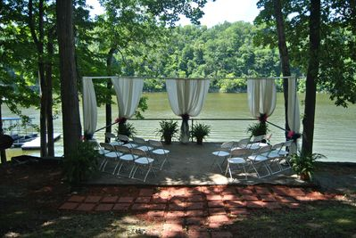 Back patio overlooking the lake, set up for an event