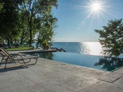 Photo for Lakefront Mansion With Heated Pool 9BR Modern Home On Private Sandy Beach