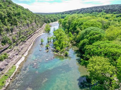 Photo for Modern river cabin with the Guadalupe River right in your backyard!!