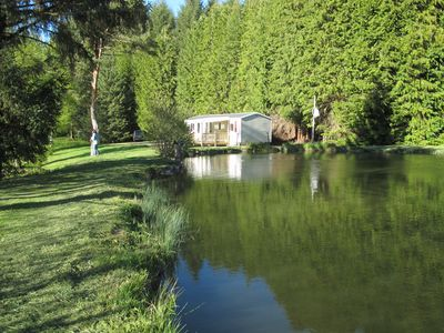 Photo for Comfortable mobile home with terrace on the edge of fishing ponds; small boat.
