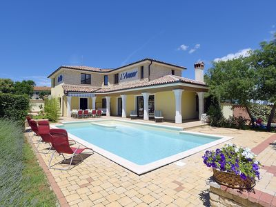 Photo for Impressive villa with private pool, 4 bedrooms, 3 bathrooms, air conditioning, WiFi, whirlpool, garage and great barbecue area