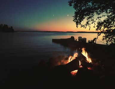 Waterfront fire pit at sunset