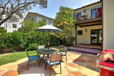 Outdoor patio seating with your own BBQ.  Private yard for your use only.  Upstairs is a separate villa.