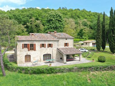 Photo for Stunning farmhouse with heated Pool and extensive views over Umbria and Tuscany
