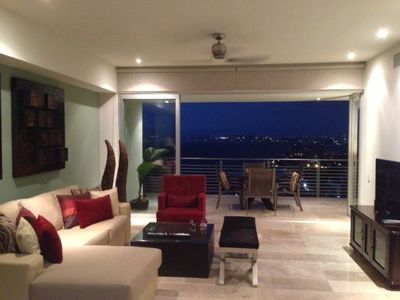 Living room with windows wide open and views of Bandaras Bay and PVR