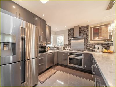 Photo for Gorgeous Home,  Close to Sky Train, Shops & Nature