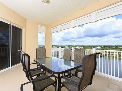 Spend every day on our 5th floor balcony at 954 Cinnamon Beach - You can spend every day out on our 5th floor balcony and never get tired of the views of Ocean Hammock lake and golf course. Then there are the sunsets; they are just stunning.