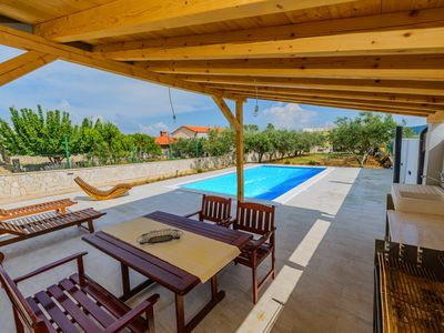 Photo for A1 apt with private beach, large pool, mooring...