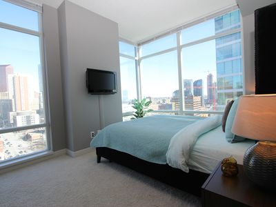Photo for Sheer Perfection Downtown STAMPEDE FIREWORKS VIEW *Free Parking* Sleeps 4!