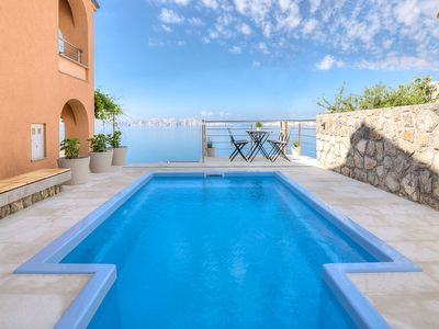 Photo for This 3-bedroom villa for up to 8 guests is located in Senj and has a private swimming pool, air-cond