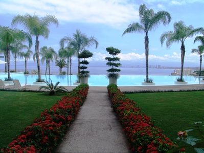 Mature and sculptured gardens overlooking and surrounding the infinity pool