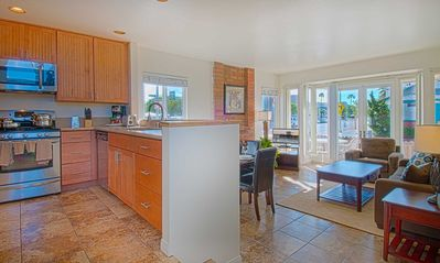 Photo for Awesome lower unit on a corner location just one house away from the warm sand!