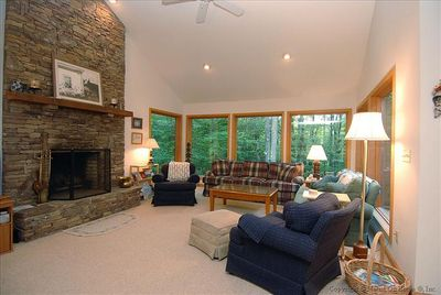 Comfortable living room with fireplace and extra large windows.
