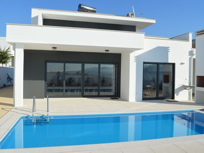 Photo for Modern villa with private swimming pool in peaceful location near well-known Nazaré