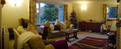 The spacious lounge with views across the glen and into the forest