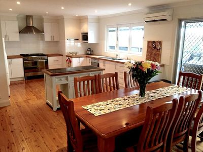 The large fully equipped kitchen and dining area.