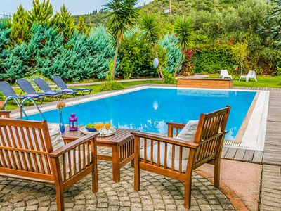 Photo for 5 minute walk from beach, restaurants and shop. Lovely gardens, spacious villa with 2 en suite bedrooms, a pool, Wi-Fi, A/C, pool towels, hairdryers and blue tooth speaker.