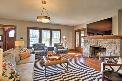 The living room boasts a wood-burning fireplace and flat-screen DirecTV.