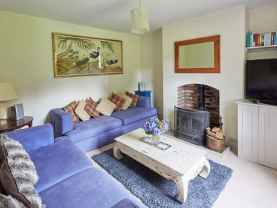 A cosy lounge with wood burner
