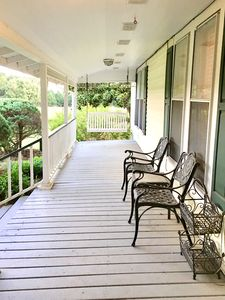 Front porch with swing to relax and enjoy.