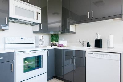 Kitchen includes dish washer, microwave, and range.