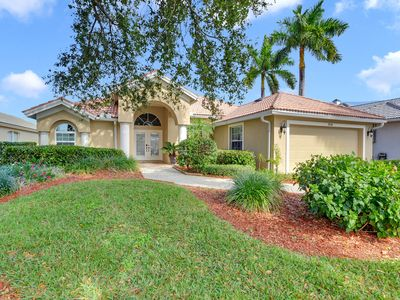 Photo for Gorgeous 3 bedroom pool home overlooking one of Briarwood's many lakes