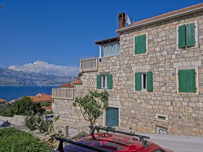 Photo for Two bedroom apartment with terrace and sea view Postira, Brač (A-11582-a)