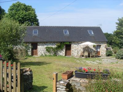 Photo for Perfectly placed for walking or biking in the Mont d'Arrées, with large garden.