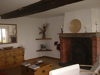 Living room with fireplace and woodburner