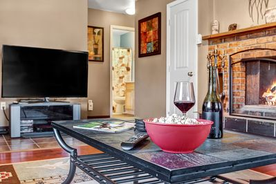 "60"" Smart TV! Relax, feast ur eyes, have some popcorn & sip on some wine!"