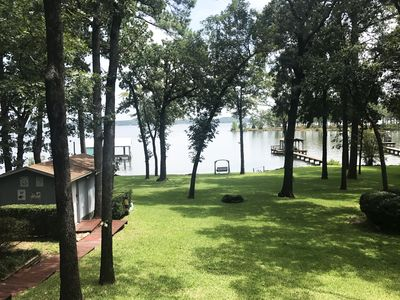 The most beautiful shaded lake yard with St. Augustine grass