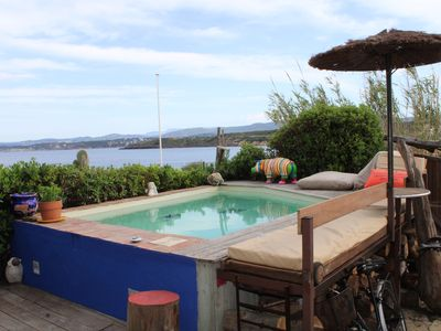Photo for WATERFRONT VILLA WITH POOL DIRECT ACCESS SAND BEACH