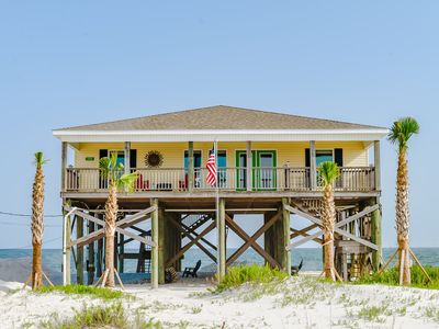 Photo for A Wave From it All! Four bedroom gulf-front, soaring ceilings, covered porch