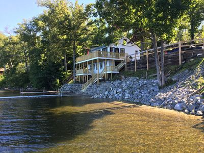 Photo for Lakeside cottage with cable tv, wifi, large decks, mountain views and a 30' dock