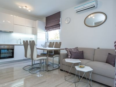 Photo for Deluxe Three-Bedroom Apartment with Terrace and Sea View