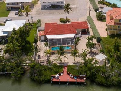 Photo for 🐠 Gorgeous 5 Bedroom waterfront Home With Split Floor Plan, fire pit, and pool!
