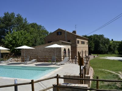 Photo for Apartment in a nineteenth-century farmhouse with swimming pool