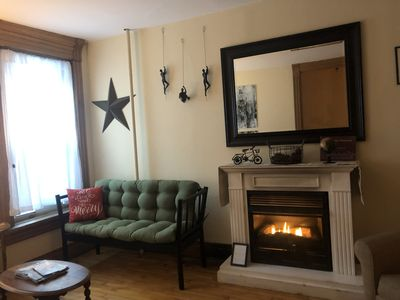 second living room w/ gas fireplace